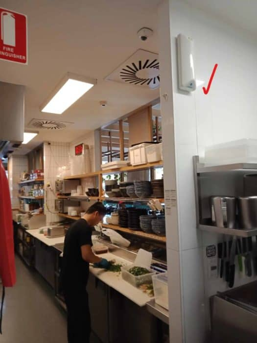 automatic fly spray on the wall in a commercial kitchen.