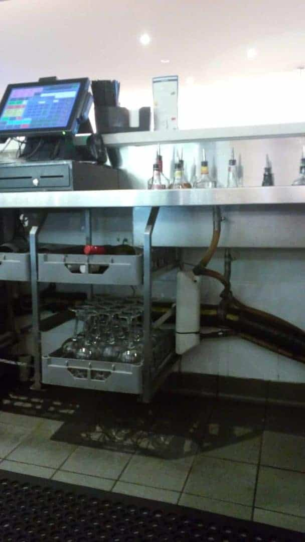 A Fly Lady Automatic Dispenser Installed Under A Bar For Vinegar Fly Control